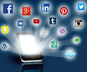 Social media networks projecting out from smartphone. Editorial